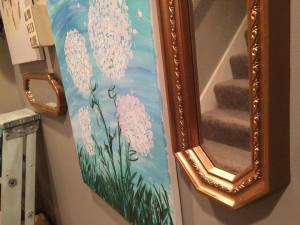 Fell in love with these fraternal-twinsy gold mirrors the second I saw them.